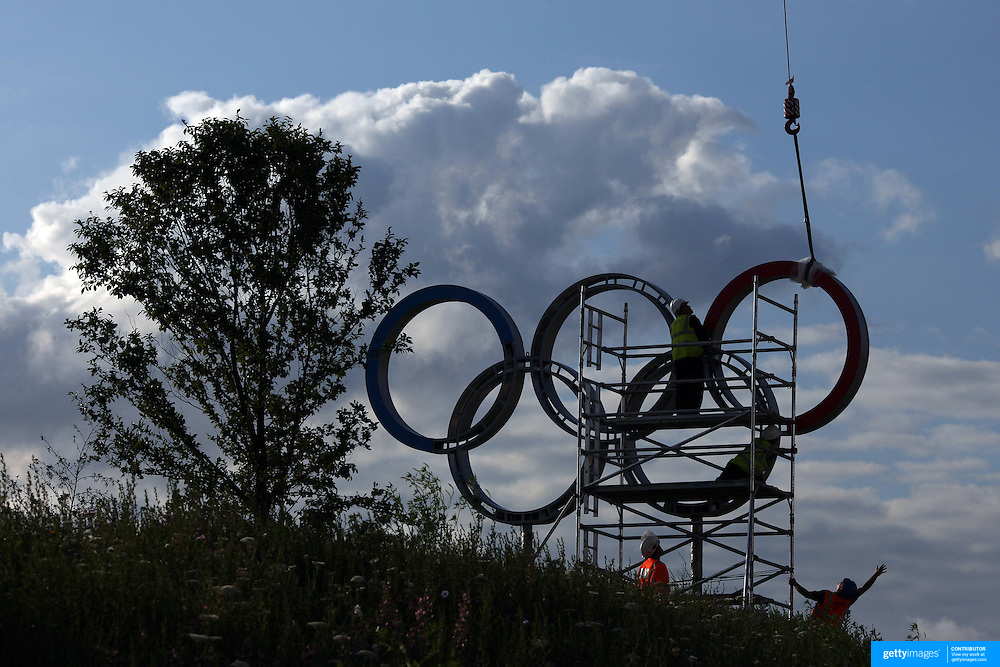 Workmen make final adjustments as they put giant Olympic rings into place at Olympic Park, Stratford during the London 2012 Olympic games final preparation. London, UK. 20th July 2012. Photo Tim Clayton