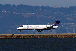 Bombardier CRJ-200 (N933EV) operated by SkyWest Airlines for United Express landing at San Francisco International Airport (KSFO), San Francisco, California, United States of America