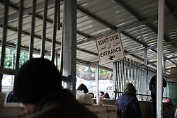 1 March 2020, Bethlehem: 'Entrance' reads a sign where people move into Checkpoint 300, where tens of thousands of Palestinians, most of them working in construction and maintenance, cross from Bethlehem to Jerusalem in the mornings.