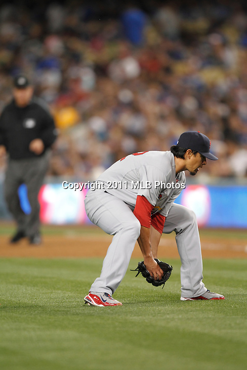 LOS ANGELES, CA - APRIL 15:  Starting pitcher Kyle Lohse #26 of the St. Louis Cardinals catches a ground ball during the game between the St. Louis Cardinals and the Los Angeles Dodgers on Friday April 15, 2011 at Dodger Stadium in Los Angeles, California. (Photo by Paul Spinelli/MLB Photos via Getty Images) *** Local Caption *** Kyle Lohse