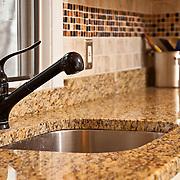 Photo of granite countertops and tile backsplash for interior designer on Cape Cod