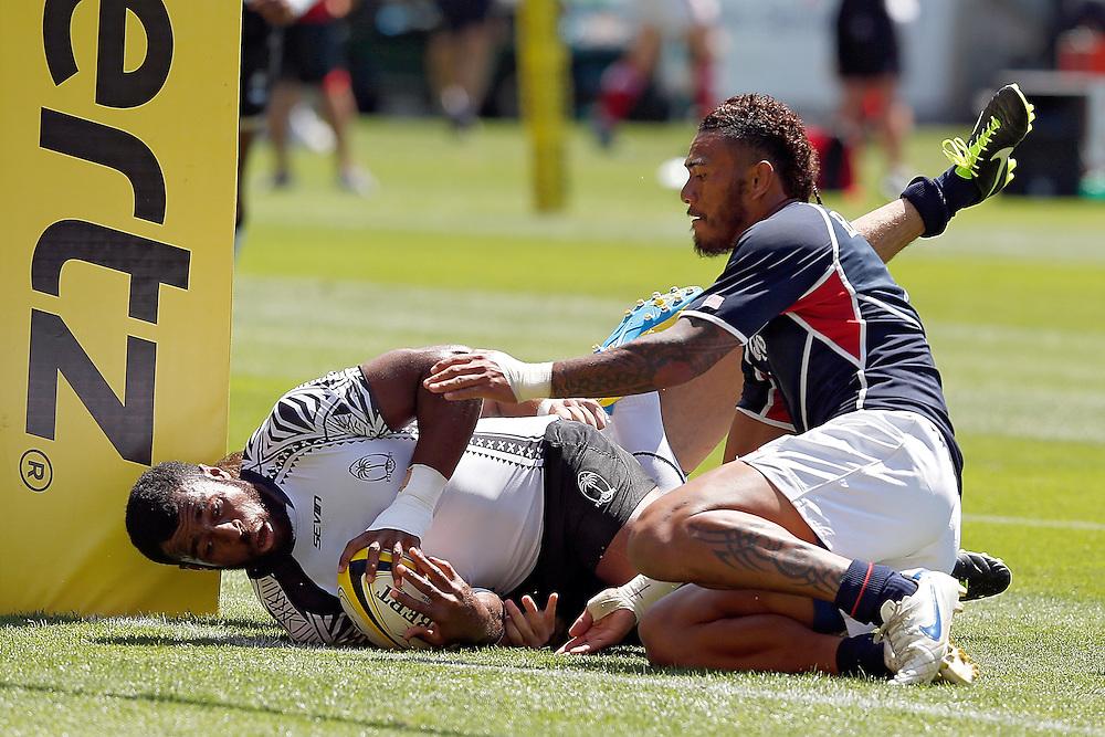 Fiji's Nemani Nagusa, left, slides up against the upright past USA's Jack Halalilo, right, during the IRB International Rugby Sevens at Westpac Stadium, Wellington, New Zealand, Saturday, February 02, 2013. Credit: Dean Pemberton.