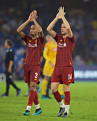 NAPLES, ITALY - Tuesday, September 17, 2019: Liverpool's Fabio Henrique Tavares 'Fabinho' (L) and captain Jordan Henderson applaud the supporters after the UEFA Champions League Group E match between SSC Napoli and Liverpool FC at the Studio San Paolo. Napoli won 2-0. (Pic by David Rawcliffe/Propaganda)