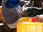 "Werke Weldemicheal, 50, is a widow and has 5 children. She collects water everyday and finds the water very clean now the animals drink from a seperate area. ""The water was very dirty with worms in it and we suffered sickness like diarohea...""Before the spring was capped, we used to suffer from the cold when we woke early to fetch water, now that problem has disappeared."""