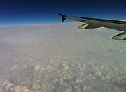 A view of a Delta Airlines plane wing and clouds below. (Sam Lucero photo)