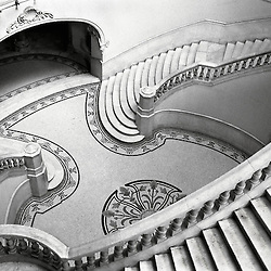 Marble stairs cascade in the entry hall of the Gran Teatro in Havana, Cuba.