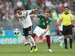 MOSCOW, June 17, 2018  Mesut Oezil (L) of Germany vies with Hector Herrera of Mexico during a group F match between Germany and Mexico at the 2018 FIFA World Cup in Moscow, Russia, June 17, 2018. (Credit Image: © Xu Zijian/Xinhua via ZUMA Wire)
