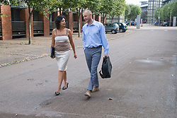 Two adults walking to work; chatting,