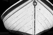 The bow of a old wooden boat in Manteno, NC in B&W.