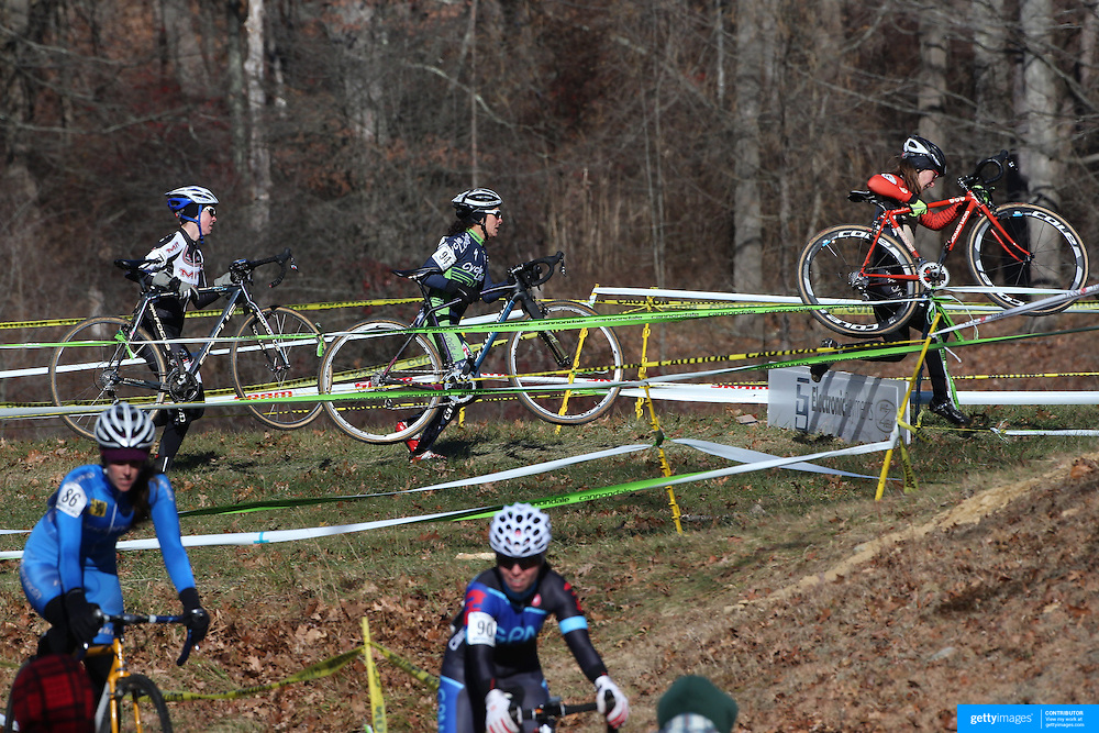 Competitors Christina Birch, (left), Lori Cooke, (centre), and Brittlee Bowman, (right), in action during the Cyclo-Cross, Supercross Cup 2013 UCI Weekend at the Anthony Wayne Recreation Area, Stony Point, New York. USA. 24th November 2013. Photo Tim Clayton