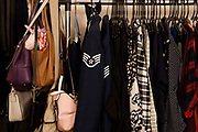 Staff Sgt. Ashleigh Buch's dress blues and purses hang near her closet on Tuesday January 24, 2017 at her apartment in Omaha.