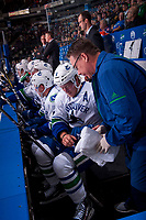 PENTICTON, CANADA - SEPTEMBER 8: Brock Boeser #6 of Vancouver Canucks receives medical attention on the bench during first period against the Winnipeg Jets on September 8, 2017 at the South Okanagan Event Centre in Penticton, British Columbia, Canada.  (Photo by Marissa Baecker/Shoot the Breeze)  *** Local Caption ***