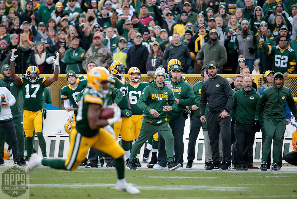 Green Bay Packers running back Aaron Jones (33) scores on a 20-yard touchdown run in Overtime to give the Packers the win. <br /> The Green Bay Packers hosted the Tampa Bay Buccaneers at Lambeau Field in Green Bay,  Sunday, Dec. 3, 2017. The Packers won in 26-20 in Overtime.   STEVE APPS FOR THE STATE JOURNAL.