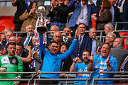 AFC Flyde Manager Dave Challinor holds the cup after the FA Trophy final match between AFC Flyde and Leyton Orient at Wembley Stadium on 19 May 2019.
