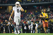 Marcus Mariota #8 of the Oregon Ducks warms up before kickoff against the Ohio State Buckeyes during the College Football Playoff National Championship Game at AT&T Stadium on January 12, 2015 in Arlington, Texas.  (Cooper Neill for The New York Times)