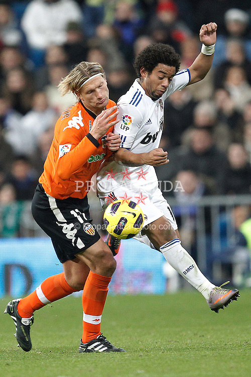 04.12.2010, Estadio Santiago Bernabéu, Madrid, ESP, Primera Division, CA Osasuna vs FC Barcelona, im Bild Real Madrid's Marcelo Vieira and Valencia's Jacikevicius during la liga match on december 4th 2010. EXPA Pictures © 2010, PhotoCredit: EXPA/ Alterphotos/ Cesar Cebolla +++++ ATTENTION - OUT OF SPAIN / ESP +++++