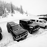 Cars and skiers along the top of Teton Pass near Wilson Wyoming.