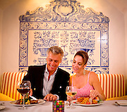 A couple eats dinner in one of the luxurious restaurants at Florida's Fisher Island