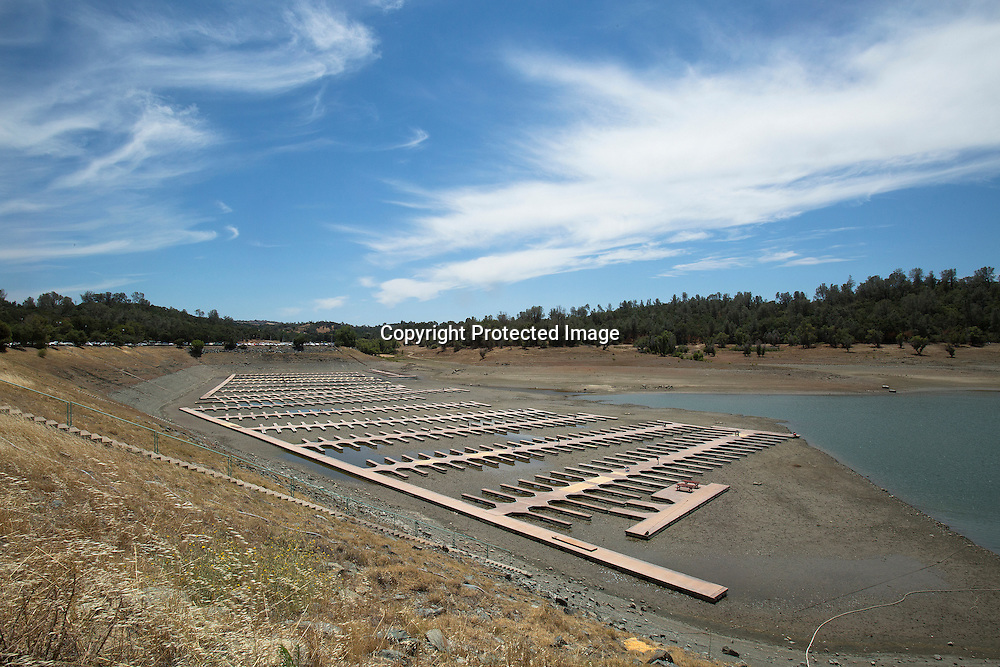 Due to the severe drought in California, Brown's Ravine Marina reveals empty docks sitting on dry dirty at Folsom Lake.