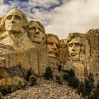 Panoramic photograph of Mount Rushmore near Keystone, South Dakota.  Four United States presidents are enshrined, George Washington, Thomas Jefferson, Theodore Roosevelt and Abraham Lincoln.