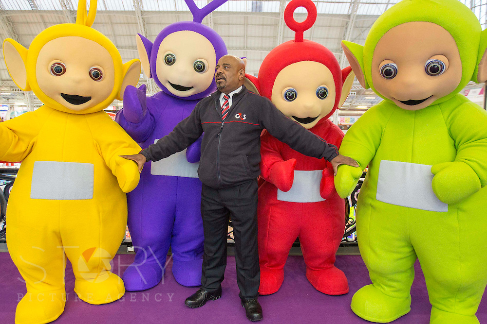 UNITED KINGDOM, London: 25 January 2016 A G4S Security staff member has fun with The Teletubbies at The Toy Fair at Olympia, the UK'S only dedicated game and hobby event with more than 260 toy and gaming brands. The fair runs until tomorrow. Rick Findler / Story Picture Agency
