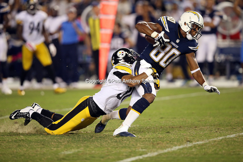 San Diego Chargers wide receiver Malcom Floyd (80) gets tackled by Pittsburgh Steelers defensive back Ross Cockrell (31) as he catches a fourth quarter pass for a gain of 32 yards and a first down inside the Steelers 30 yard line during the 2015 NFL week 5 regular season football game against the Pittsburgh Steelers on Monday, Oct. 12, 2015 in San Diego. The Steelers won the game 24-20. (©Paul Anthony Spinelli)
