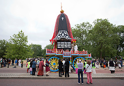 © Licensed to London News Pictures. 09/06/2013. London, UK. A chariot waits to be pulled by followers of the Hare Krishna movement as part of the festival of 'Rathayatra' in Hyde Park, London, today (09/06/2013). The parade, also known as the 'Festival of Chariots', is the biggest street festival celebrated by members of the Krishna followers and, in London, features three huge, wooden chariots containing the smiling figures of Lord Jagannatha, Lady Subhadra and Lord Balarama being pulled by hand from Hyde Park to Trafalgar Square.  Photo credit: Matt Cetti-Roberts/LNP