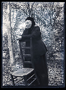 senior woman in garden setting France ca 1920s