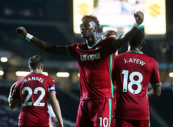 Swansea City's Tammy Abraham celebrates after scoring their third goal during the Carabao Cup, Second Round match at Stadium MK, Milton Keynes.