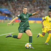 GRENOBLE, FRANCE June 18. Emily Gielnik #15 of Australia crosses the ball defended by Deneisha Blackwood #14 of Jamaica during the Jamaica V Australia, Group C match at the FIFA Women's World Cup at Stade des Alpes on June 18th 2019 in Grenoble, France. (Photo by Tim Clayton/Corbis via Getty Images)