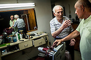 John Talarico talks with Monessen Mayor Lou Mavrakis in Tallarico's barber shop in the basement of his home in Monessen. Pa.<br /> <br /> Monessen, a third-class city, faces the same problems as th other former steel towns — declining population and tax revenue after the mills shut down. The city's population has dropped to 7,600 from a high of 20,268 in 1930.