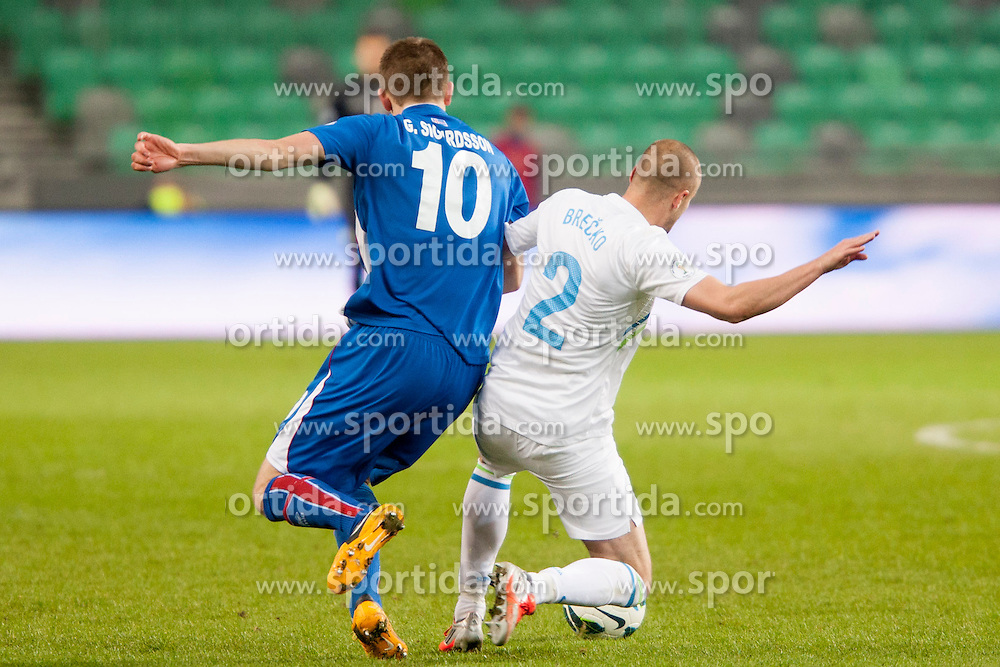 Gylfi Thor Sigurdsson #10 of Iceland and Miso Brecko #2 of Slovenia during football match between National teams of Slovenia and Iceland in Group E of FIFA World Cup 2014 Qualification on October 12, 2012 in SRC Stozice, Ljubljana, Slovenia. (Photo By Urban Urbanc / Sportida)