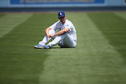 LOS ANGELES, CA - APRIL 28:  Clayton Kershaw #22 of the Los Angeles Dodgers stretches before the game against the Milwaukee Brewers on Sunday, April 28, 2013 at Dodger Stadium in Los Angeles, California. The Dodgers won the game 2-0. (Photo by Paul Spinelli/MLB Photos via Getty Images) *** Local Caption *** Clayton Kershaw