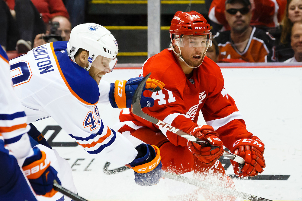 Mar 9, 2015; Detroit, MI, USA; Edmonton Oilers left wing Ryan Hamilton (48) and Detroit Red Wings right wing Luke Glendening (41) in the third period at Joe Louis Arena. Detroit won 5-2. Mandatory Credit: Rick Osentoski-USA TODAY Sports