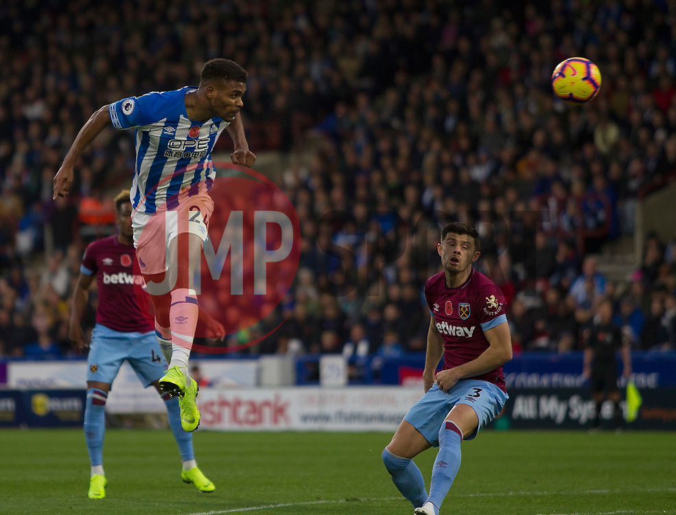 Steve Mounie of Huddersfield Town heads at goal - Mandatory by-line: Jack Phillips/JMP - 10/11/2018 - FOOTBALL - The John Smith's Stadium - Huddersfield, England - Huddersfield Town v West Ham United - English Premier League