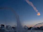 The fountains at downtown Dayton, Ohio, erupt at sunset.