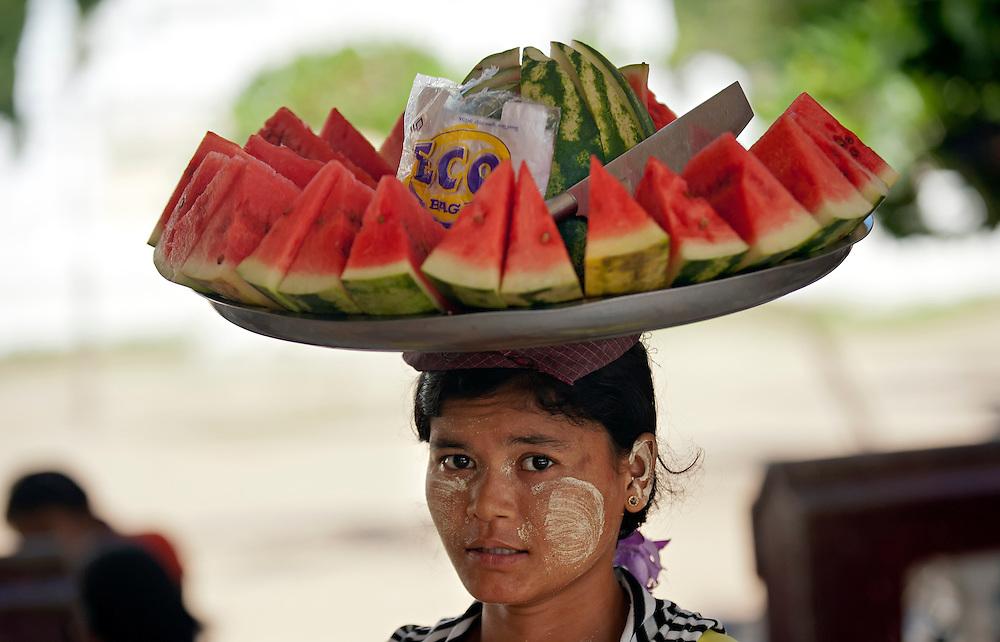A woman selling watermellon, Myanmar.