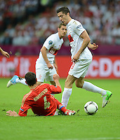 FUSSBALL  EUROPAMEISTERSCHAFT 2012   VORRUNDE Polen - Russland             12.06.2012 Robert Lewandowski (re, Polen) gegen Sergei Ignashevich (li, Russland)