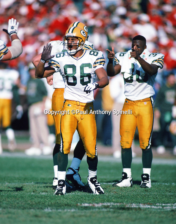 Green Bay Packers wide receiver Antonio Freeman (86) gets a high five from teammates as they celebrate during the NFL NFC Divisional Playoff football game against the San Francisco 49ers on Jan. 6, 1996 in San Francisco. The Packers won the game 27-17. (©Paul Anthony Spinelli)