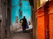 05 MARCH 2017 - KATHMANDU, NEPAL: A woman walks on a street in Kathmandu, Nepal.     PHOTO BY JACK KURTZ