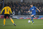 AFC Wimbledon midfielder Callum Reilly (33) dribbling and about to take on Southend United midfielder Mark Milligan (5) during the EFL Sky Bet League 1 match between AFC Wimbledon and Southend United at the Cherry Red Records Stadium, Kingston, England on 1 January 2020.