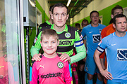 Forest Green Rovers Lee Collins(5) with mascot during the EFL Sky Bet League 2 match between Forest Green Rovers and Coventry City at the New Lawn, Forest Green, United Kingdom on 3 February 2018. Picture by Shane Healey.