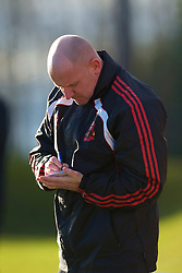 LIVERPOOL, ENGLAND - Tuesday, January 11, 2011: Liverpool's Reserve team manager John McMahon makes notes during the FA Premiership Reserves League (Northern Division) match against Sunderland at the Kirkby Academy. (Pic by: David Rawcliffe/Propaganda)
