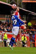 Mark Molesley beats Scott Tanser to the ball during the The FA Cup match between Aldershot Town and Rochdale at the EBB Stadium, Aldershot, England on 7 December 2014.