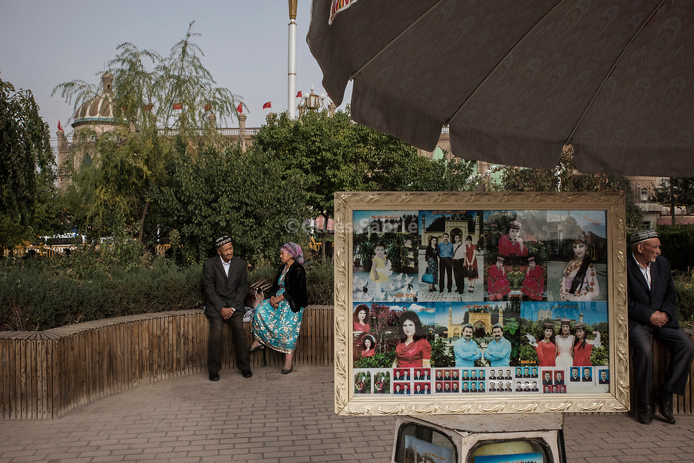 Kashgar. October 1st, 2017<br /> Uyghurs next to a souvenir photo booth in front of the Id Kah mosque.