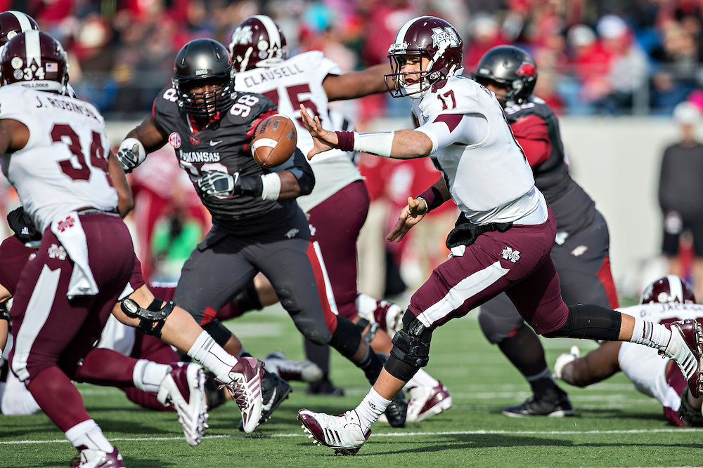 LITTLE ROCK, ARKANSAS - NOVEMBER 23:  Tyler Russell #17 of the Mississippi State Bulldogs pitches back the ball during a game against the Arkansas Razorbacks at War Memorial Stadium on November 23, 2013 in Little Rock, Arkansas.  The Bulldogs defeated the Razorbacks 24-17.  (Photo by Wesley Hitt/Getty Images) *** Local Caption *** Tyler Russell