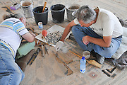 Archeologists restore a mosaic floor in Caesarea, Israel