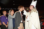 DENVER, CO - MAY 7: Families pose following confirmation during the Archdiocese of Denver's inaugural Sealed and Sent event at the Denver Coliseum on May 7, 2016 in Denver, Colorado. (Photo by Travis Haughton for the Archdiocese of Denver)