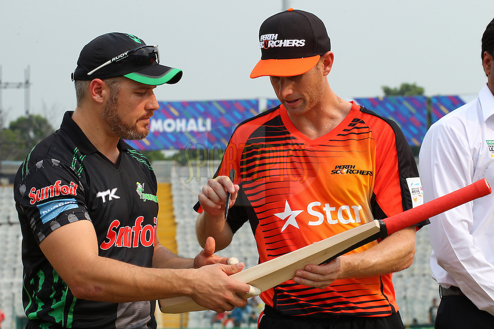 Morne VAN WYK (Captain) and Adam VOGES (Captain) sign the MCC bat at the toss during match 4 of the Oppo Champions League Twenty20 between the Dolphins and the Perth Scorchers held at the Punjab Cricket Association Stadium, Mohali, India on the 20th September 2014<br /> <br /> Photo by:  Ron Gaunt / Sportzpics/ CLT20<br /> <br /> <br /> Image use is subject to the terms and conditions as laid out by the BCCI/ CLT20.  The terms and conditions can be downloaded here:<br /> <br /> http://sportzpics.photoshelter.com/gallery/CLT20-Image-Terms-and-Conditions-2014/G0000IfNJn535VPU/C0000QhhKadWcjYs
