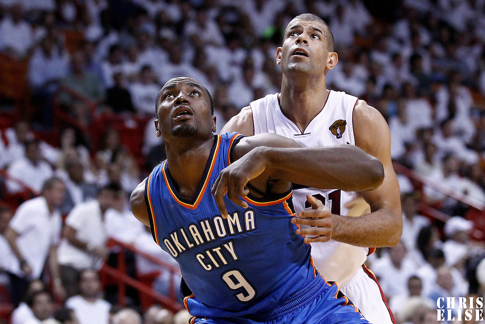 19 June 2012: Oklahoma City Thunder power forward Serge Ibaka (9) vies for the rebound with Miami Heat small forward Shane Battier (31) during the third quarter of Game 4 of the 2012 NBA Finals, Thunder at Heat, at the AmericanAirlinesArena, Miami, Florida, USA.